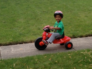 """This is my favorite Ben smile ever. It's the """"look at me, I'm a big boy pedaling my bike"""" smile. It's pretty sweet."""