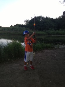 We did a bit of fishing this summer and Mason hooked his first bass a little while back. After catching a plastic bag and a bullfrog that tried to swallow the entire bobber he was very excited to reel in a fish... until I asked him to hold it.